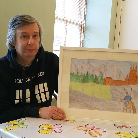 Ian McMonigle with his artwork